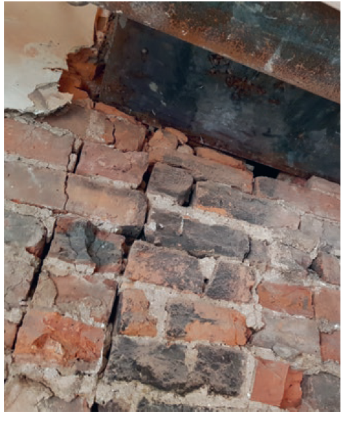 Photo 2: Damage to party wall by chimney removal