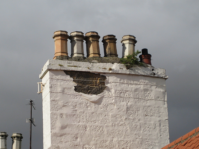 A traditional chimney in poor condition.